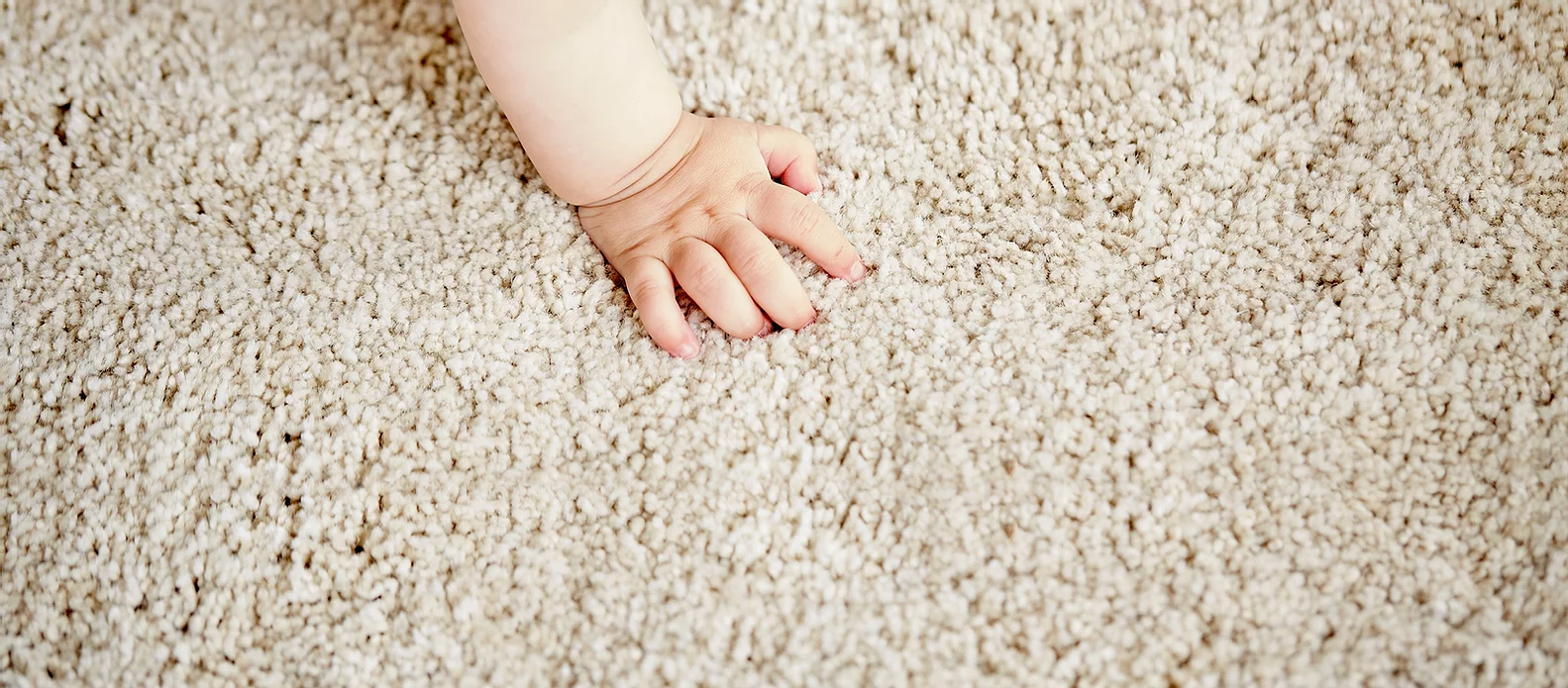 carpet with baby hand